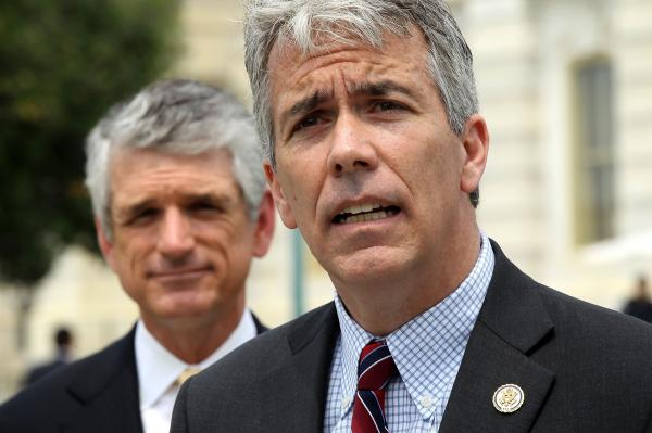 <strong>OUT:</strong> Illinois Republican Rep. Joe Walsh (foreground), with Virginia Rep. Scott Rigell, speaks during a May news conference on Capitol Hill. Walsh, a Tea Party freshman, lost to Democrat Tammy Duckworth.