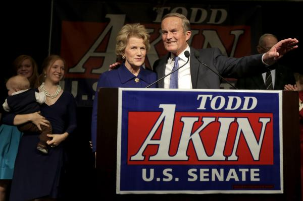 <strong>OUT:</strong> Missouri Republican Rep. Todd Akin and his wife, Lulli, acknowledge supporters before Akin makes his concession speech to incumbent Democratic Sen. Claire McCaskill on Tuesday in Chesterfield, Mo.