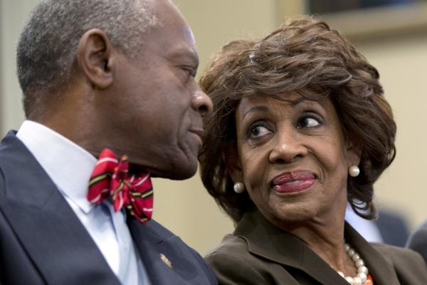 <strong>IN:</strong> California Democratic Rep. Maxine Waters smiles at her husband, Sidney Williams, during a House Ethics Committee hearing in September. Waters was cleared of charges that she steered a $12 million federal bailout to a bank where her husband owns stock.