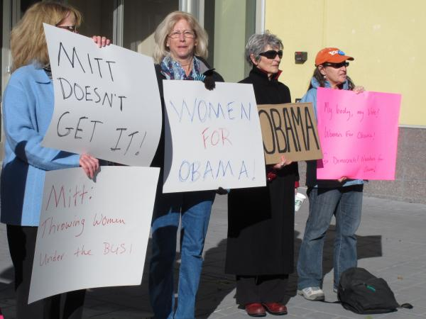 On Oct. 24, women backing President Obama protest outside a convention center in Reno, Nev., where Republican Mitt Romney was giving a campaign speech. Exit polls show significant support from women was a key factor in Obama's victory over Romney in Nevada.