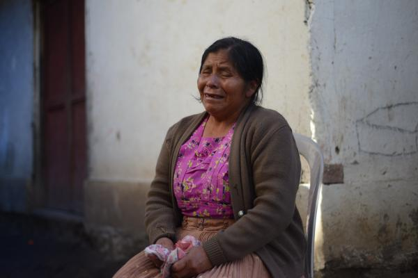 A relative mourns the ten members of the Vasquez family who died in the earthquake in the San Cristobal Cuchu municipality in San Marcos, Guatemala.