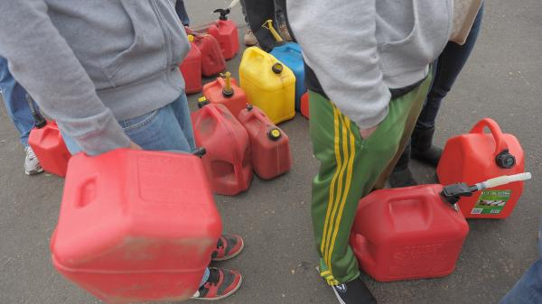 One way to avoid the odd-even rationing rule is to line up with a gas can and no car, as these people were doing last week in Matawan, N.J.