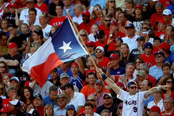 A fan holds up the Texas state flag during Game Two of the ALCS during the 2010 MLB Playoffs.