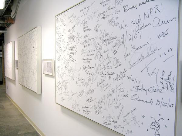 "The ""Signature Wall,"" where interview guests and notable NPR West visitors passing through leave notes... and the occasional doodle."