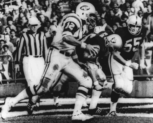"""The Heidi Game"": New York Jets quarterback Joe Namath sweeps around the right side past Oakland defenders Ralph Oliver and Dan Conners to score from the one-yard line during the second quarter against the Oakland Raiders in Oakland on Nov. 17, 1968."