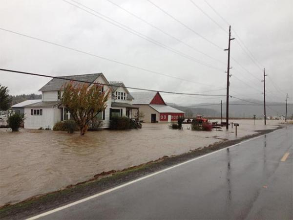Flood waters buried  E. Main Street and Brown Park in Gaston, Oregon Monday. Photo by Randy Hoodenpyl
