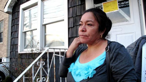 Rosa Maria Ramirez lost most of her belongings in the storm and is moving out of her damaged house on Staten Island. Because she's undocumented, she doesn't qualify for federal financial disaster assistance.