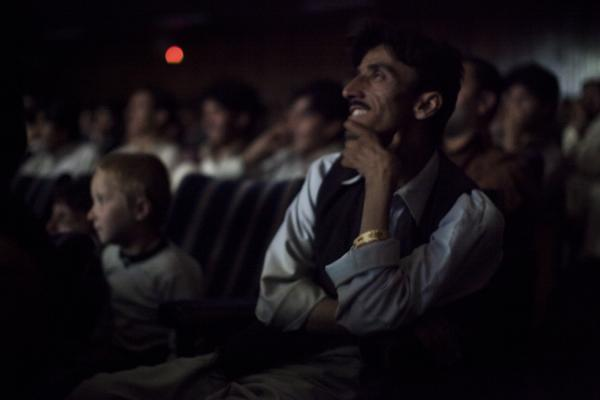 The audience at Pamir Cinema in Kabul watches a Pakistani film