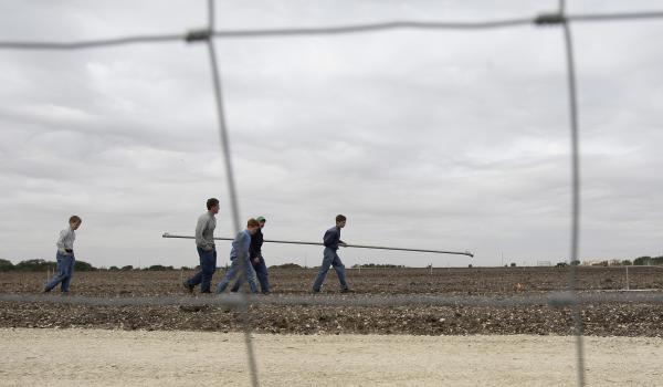 Boys walk through a potato field at the Yearning for Zion Ranch in Eldorado, Texas, in 2009.