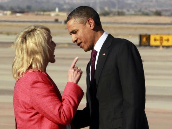 Arizona Gov. Jan Brewer points at President Obama after he arrived at Phoenix-Mesa Gateway Airport on Wednesday.