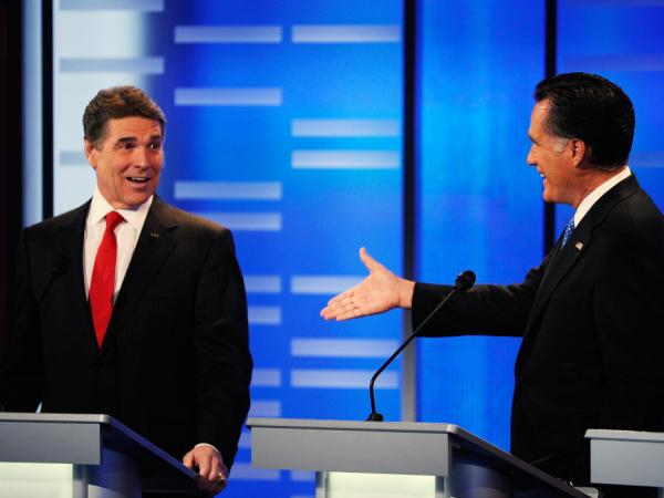 During a Dec. 10 debate in Iowa, Mitt Romney (right) bet $10,000 that Texas Gov. Rick Perry was wrong about what Romney had written concerning a national health care mandate.