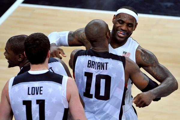 LeBron James of the United States celebrates winning the Men's Basketball gold medal game between the United States and Spain with teammate Kobe Bryant.