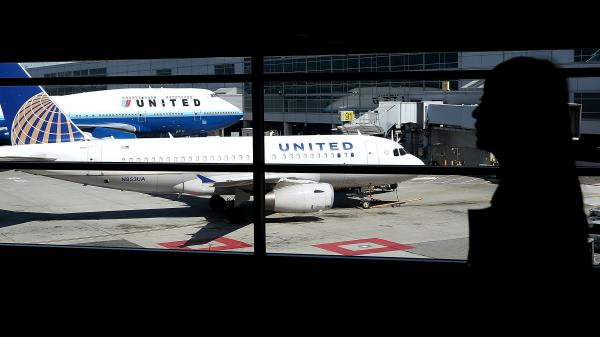 Two United Airlines planes sit at a terminal at San Francisco International Airport Friday. The airport briefly refused to accept any domestic arrivals Tuesday, after a computer crash disrupted United's system.