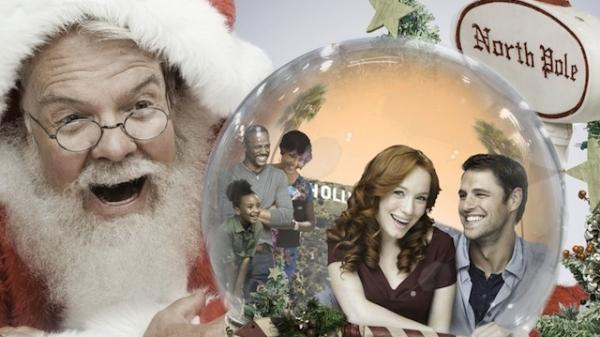 Why yes, this is a promotional image for a real holiday Hallmark movie called Annie Claus Is Comin' To Town. That's Annie Claus, Santa's daughter, inside the snow globe being stared at by her father.