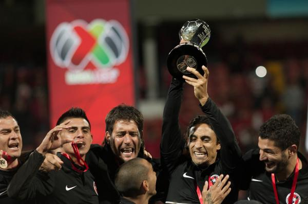 Players of Tijuana celebrate their victory over Toluca after their Mexican Apertura tournament final football match on Sunday.