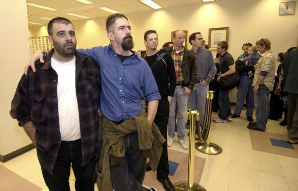 Will Gerome, left, and partner John Kirby wait their turn with other gay and lesbian couples to apply for a marriage license at the King County Administration Building in Seattle, Washington.