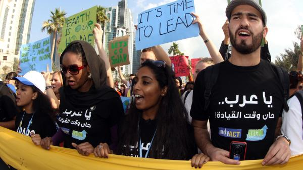 Climate activists at a rally in Doha on December 1, 2012.