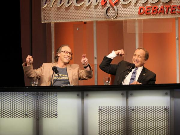"Lawrence Krauss and Michael Shermer react to their victory after arguing that ""Science Refutes God"" in an <em>Intelligence Squared U.S.</em> debate."