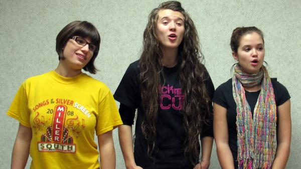 Three OHDELA students — from left, Hannah Fulks, Erika Blon and Randi Beatty — sing together. The online school's chorus meets for in-person practice once each quarter.