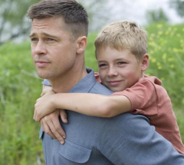 Brad Pitt (left) and Laramie Eppler (right) in Terrence Malick's <em>The Tree of Life</em>.