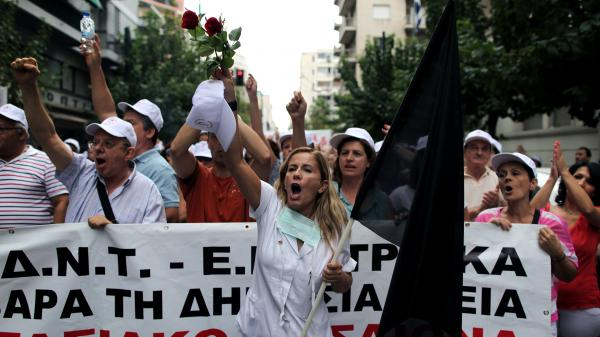 Public hospital workers protest outside the Health Ministry in central Athens in October. Hospital budgets have been slashed by more than half.