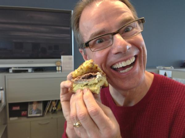 Robert befriends the sandwich before eating it.