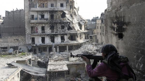 The Syrian military fired Scud missiles on rebel positions in northern Syria this week, a Pentagon source says. Here, a rebel fighter takes a position last month in the northern city of Aleppo, the scene of heavy fighting in recent months.