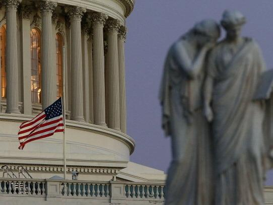 Flags were were lowered to half-staff at the U.S. Capitol and other federal buildings after Friday's mass shooting in Newtown, Conn.