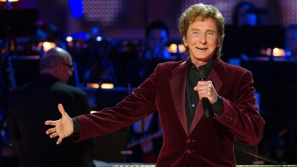 Barry Manilow onstage during a tree lighting in Los Angeles in November.
