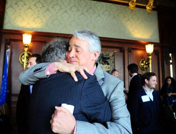 Following the Military Voices launch event, NPR <em>Weekend Edition Saturday</em> host Scott Simon hugs Gordon Bolar, General Manager of NPR Member Station WMUK in Kalamazoo, Michigan. In 2007, Bolar's son Matthew was killed by a roadside bomb in Iraq.