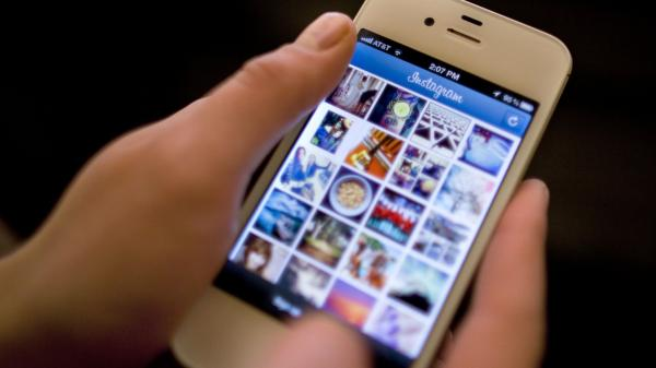 Instagram was the target of a storm of outrage on Twitter and other sites after the company announced a change in its user agreement that hinted that it might use shared photos in ads.