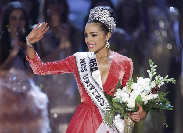 Newly crowned Miss Universe, Olivia Culpo, waves to the crowd after winning the pageant in Las Vegas on Wednesday, December 19, 2012.