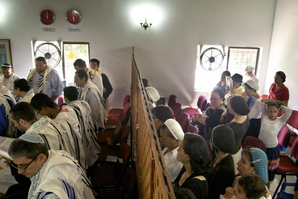 The congregation prays at the synagogue in Bello.