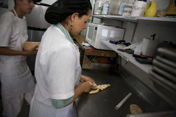 Galit Zapata, a member of the Jewish community in Bello, prepares bread in the family's kosher bakery.