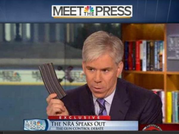 <em>Meet the Press</em> host David Gregory, holding what he said was a high capacity magazine, during Sunday's broadcast.