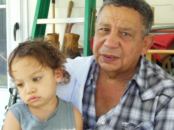 Angel Cruz with grandson Christopher. Cruz came to the U.S. from the Dominican Republic in 1964.