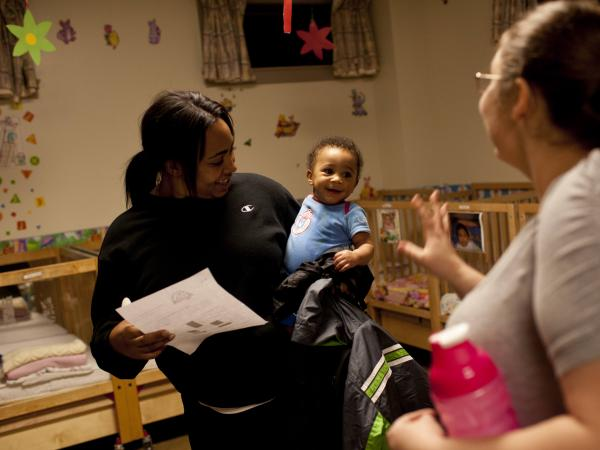 Devora Trapp, 24, picks up her 8-month-old son, Dardarius Taylor, late one evening at the Opportunity House's Second Street Learning Center, a 24-hour day care center for low-income families in Reading, Pa.