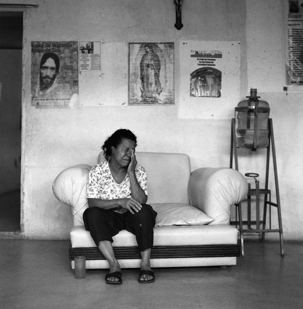 A frightened Honduran migrant who became separated from her husband when he was apprehended and detained by Mexican immigration officials seeks refuge at the Home of Mercy migrant shelter in the town of Arriaga. June 2009.