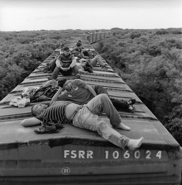 Undocumented Central American migrants ride a freight train through the southern Mexican state of Oaxaca during the first leg of the journey by rail to the U.S. border. July 2010.