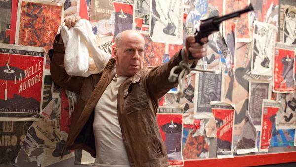 Joe (Bruce Willis) fights a younger version of himself in <em>Looper</em>.