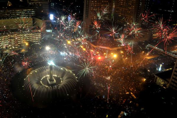Fireworks are launched over Jakarta's main business road to mark the new year.
