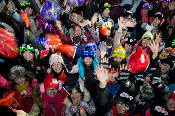 People cheer following a count-down event at the Summer Palace in Beijing.