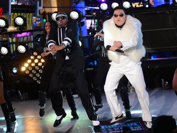South Korean singer PSY performs with US singer MC Hammer during New Year's Eve celebrations in Times Square in New York.