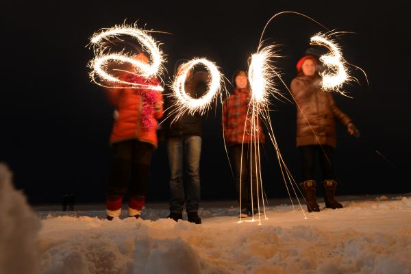 "People write ""2013"" with sparklers as they celebrate the New Year at the shore of the Gulf of Finland in the city of Zelenogorsk."