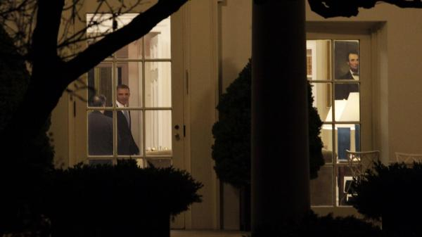 "President Obama was in the Oval Office late Tuesday night as the House finished voting on the ""fiscal cliff"" deal. After praising the passage, he left for Hawaii to resume a vacation with his family."