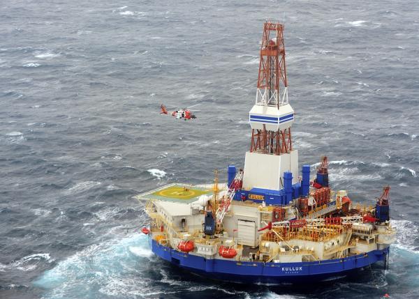 A Coast Guard helicopter crew conducts the 13th hoist of 18 crewmen from the mobile drilling unit Kulluk on Saturday, Dec. 29, 2012, 80 miles southwest of Kodiak City, Alaska. On Monday, the Kulluk ran aground on Sitkalidak Island.