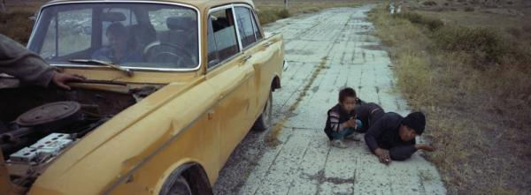 Vasily and Erasu Sokolov wait for their friends' car to be fixed while they are heading to the city.