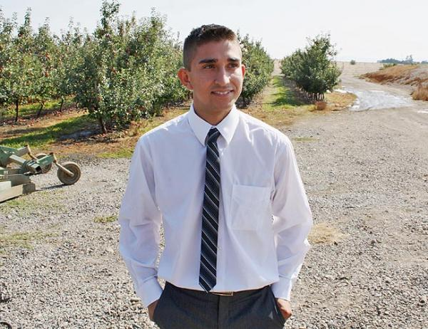 Pablo Gonzalez, 21, grew up near this orchard outside of Zillah, Wash. He's now running for the state House in this newly majority-Latino district. Photo by Jessica Robinson