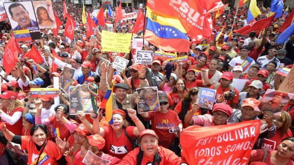 Venezuelan President Hugo Chavez remained in Cuba, where he's receiving treatment for cancer, and was not present for his planned inauguration in Caracas on Thursday. However, thousands of supporters gathered outside the presidential palace to show their backing.