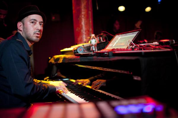 Mark de Clive-Lowe led his band on piano, keyboards and electronics.